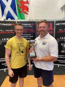 Mark Haydock receiving the Health & Strength Trophy from promoter Paul Barette